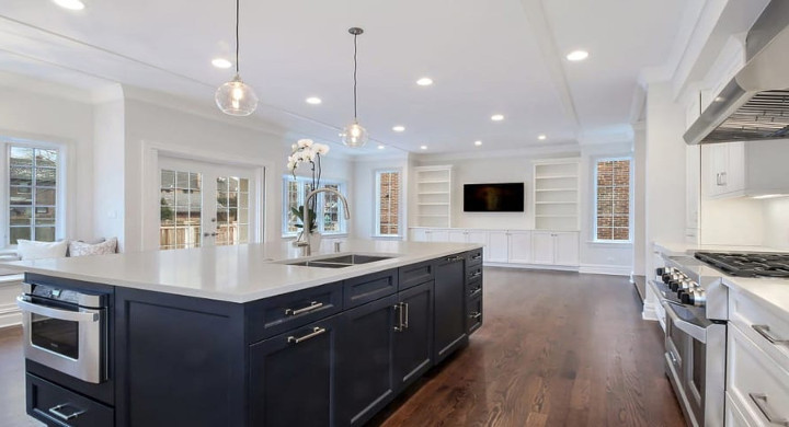 Wilmette traditional kitchen remodel project with kitchen Island and ovens with industrial hood