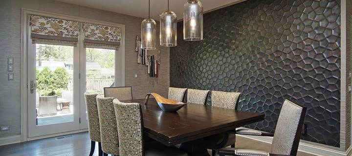 Beautiful dining room space with comfortable chairs and amazing wall decor in Highland Park