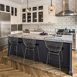 Spacious classically kitchen design with three stylish bar chairs in Chicago
