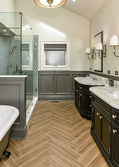 Functional stylish bathroom with glass-enclosed shower and two mirrors in Chicago