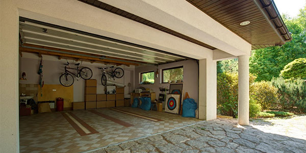 House with open garage building after renovation