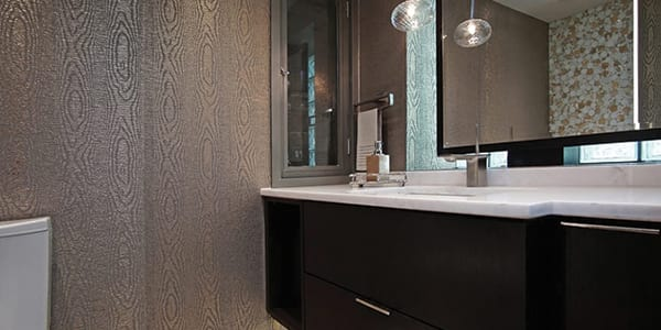 Lake Forest bathroom design project photo with dark brown finish, accent wallpaper, two tone floor tile