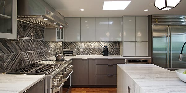 Modern grey color kitchen design with two-toned cabinets after remodeling in Lake Forest
