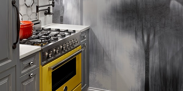Elegant grey kitchen design with bright yellow stove and wall decor in Chicago