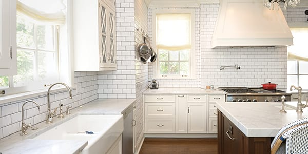 Modern and luxury kitchen design with white cabinet and wood flooring in Kenilworth