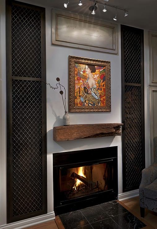 Relaxing open living space with modern fireplace and bright painting project photo in Chicago