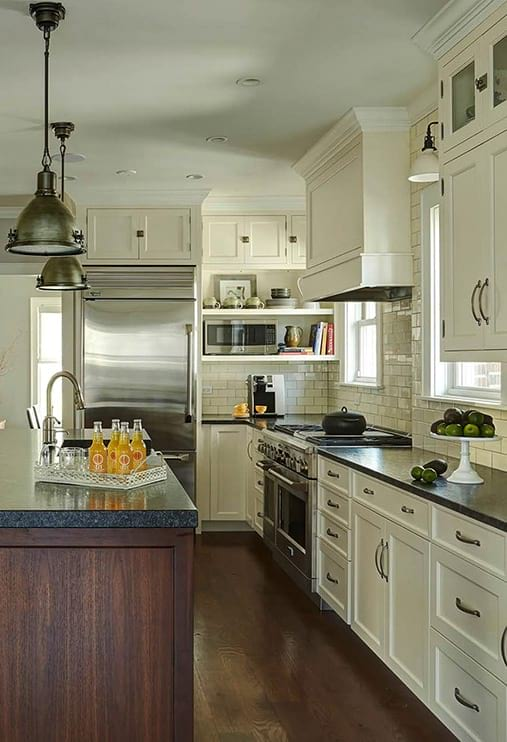 Stylish kitchen with white cabinets and elegant interior decor on the wall project photo in Oak