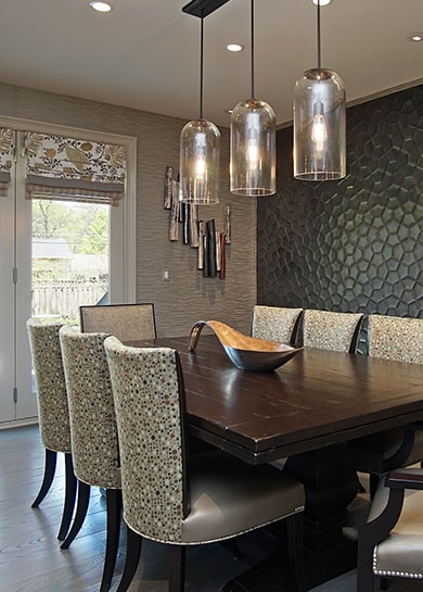 Elegant dining room with modern wall accents in Highland Park