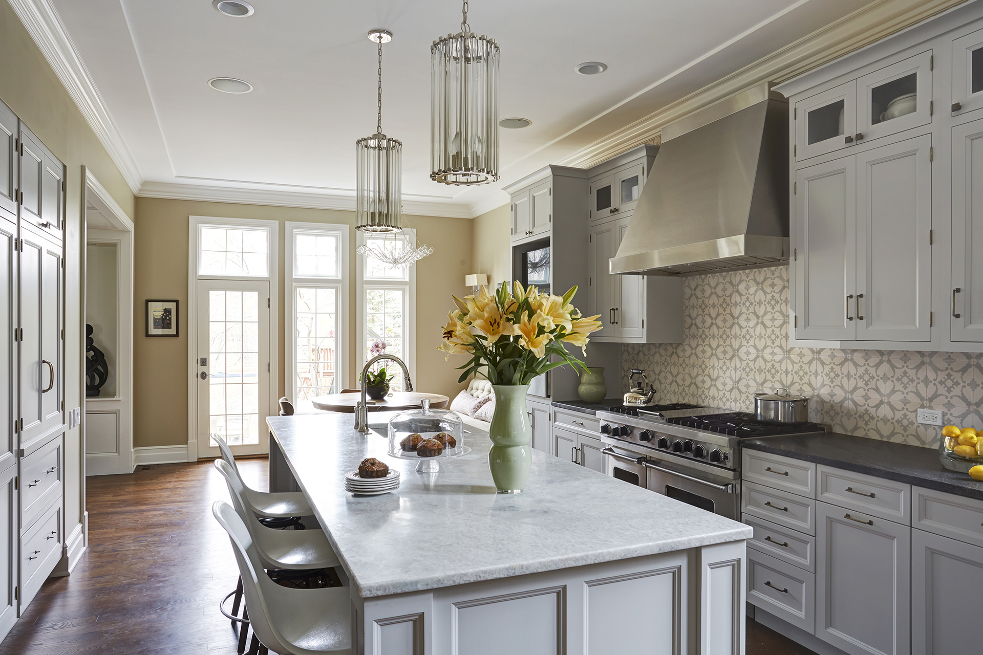 Modern Kitchen Design With White Cabinets And Island In Winnetka