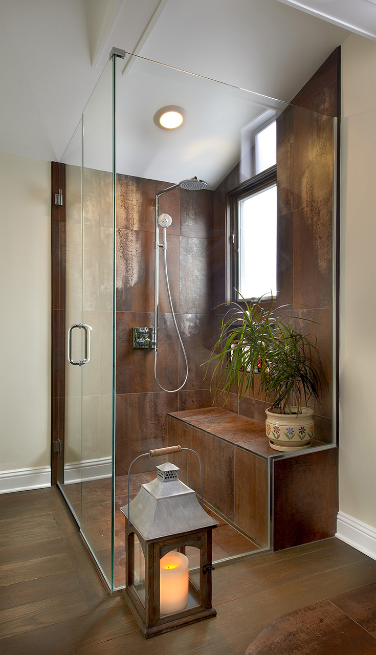 Stylish brown enclosed glass shower with lantern element in Chicago