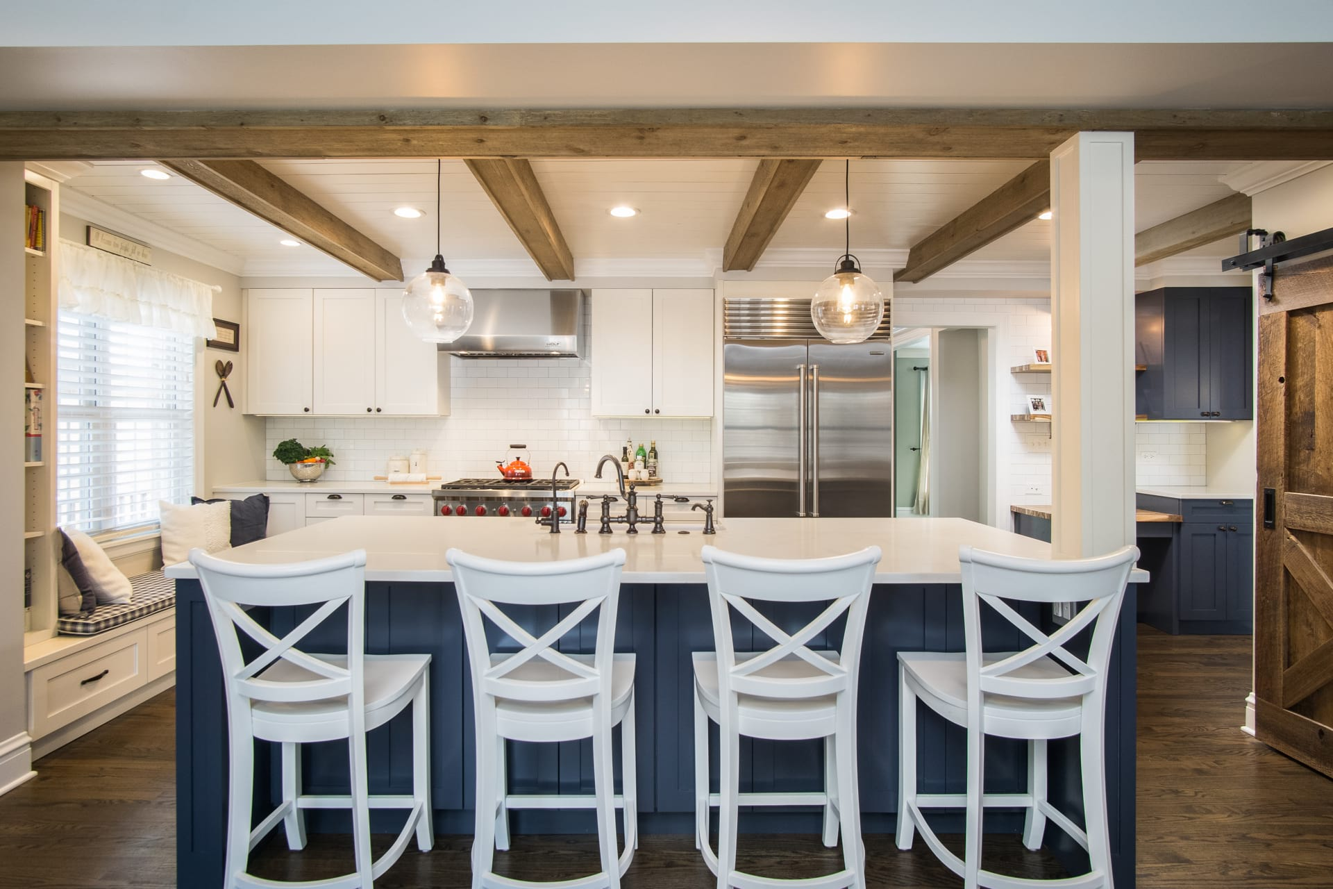 open white kitchen with chairs in chicago