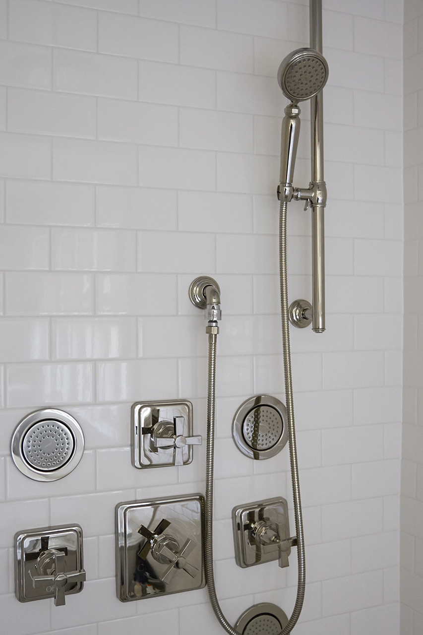 Small shower cabin design with white color tiles in Oak Park