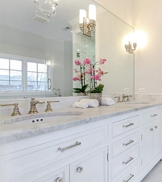 White, grey, carrera marble bathroom design in Wilmette