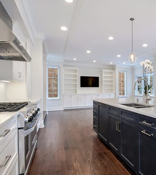 Wilmette traditional kitchen remodeling project with island houses the sink