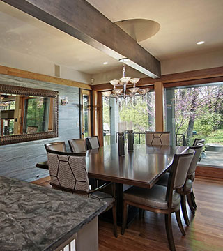 Classic kitchen dining area design with hardwood floors in Lake Forest