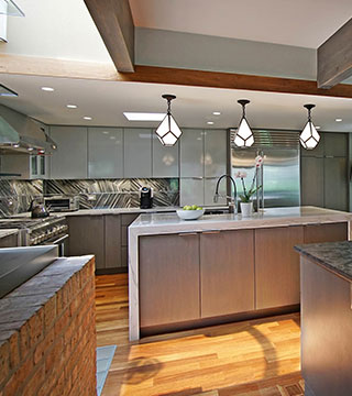 Fabulous two tone kitchen cabinets combined with big eating area in Lake Forest