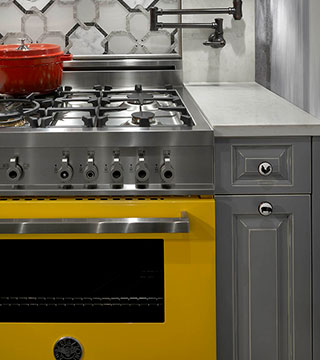 Stylish yellow stove design after kitchen remodeling in Chicago