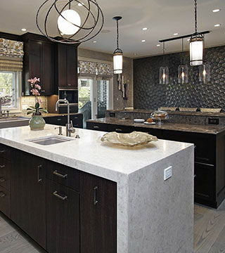 Large luxury white and dark brown kitchen with huge modern island and breakfast bar in Highland Park